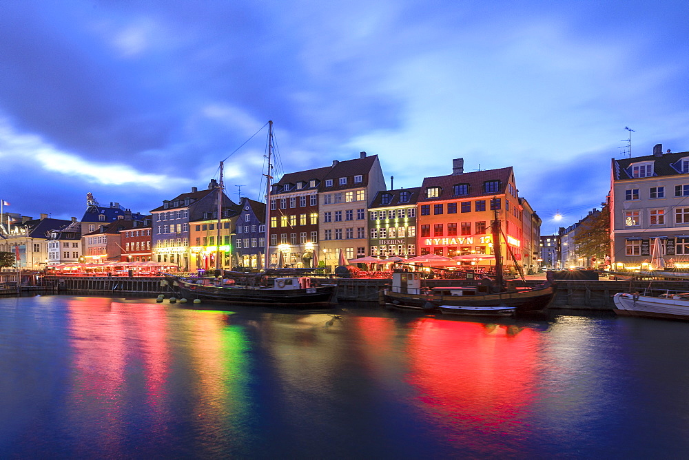 Night view of the illuminated harbour and canal of the entertainment district of Nyhavn, Copenhagen, Denmark, Europe