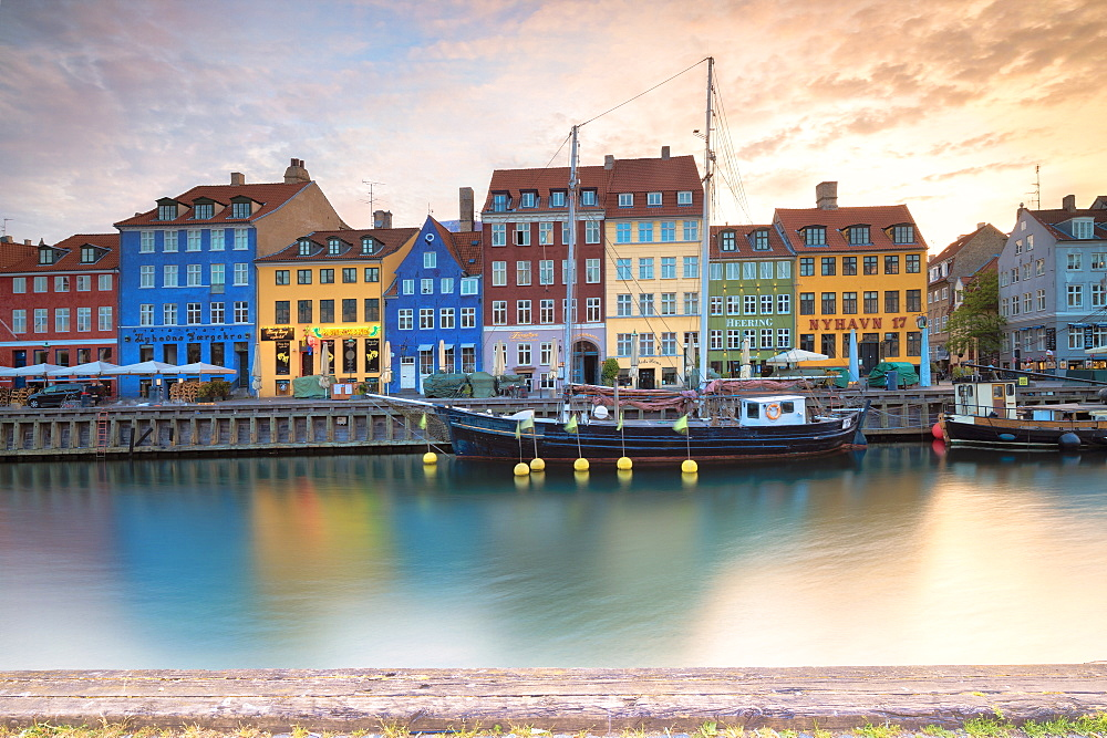 Sunrise on the colourful facades along the harbor in the district of Nyhavn, Copenhagen, Denmark, Europe