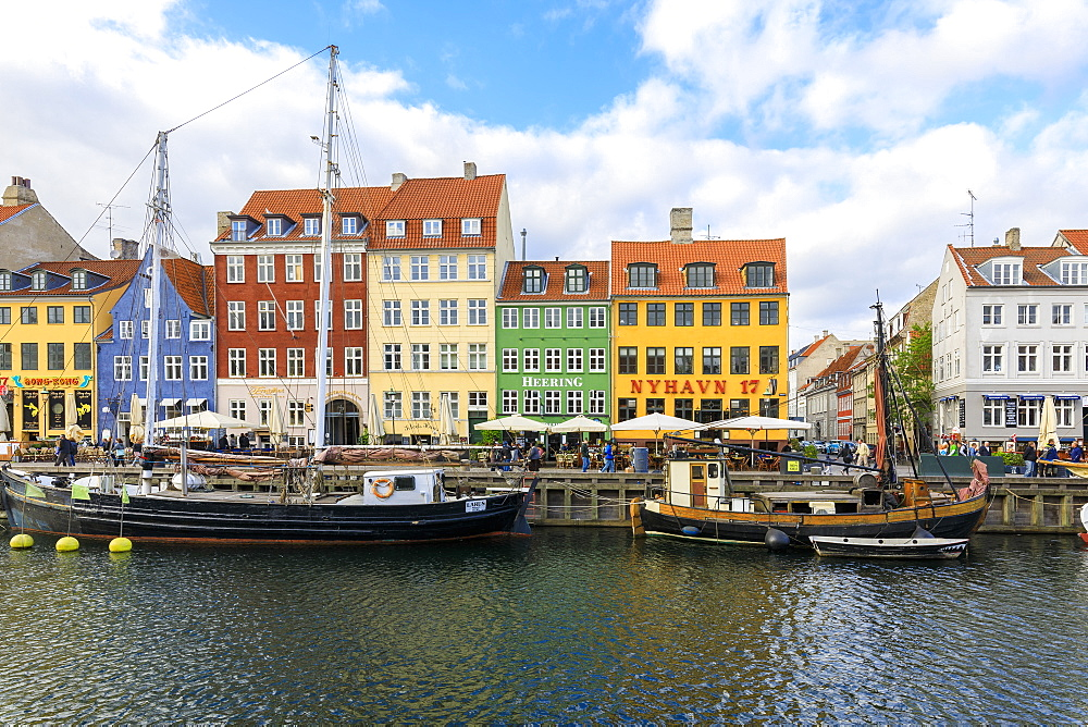 Colourful facades along canal and entertainment district of Nyhavn, Copenhagen, Denmark, Europe