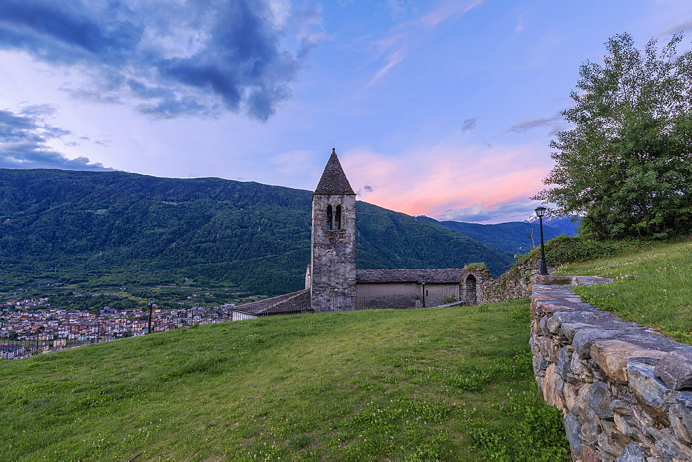 Old bell tower of the Xenodochio of Santa Perpetua at sunrise, Tirano, province of Sondrio, Valtellina, Lombardy, Italy, Europe