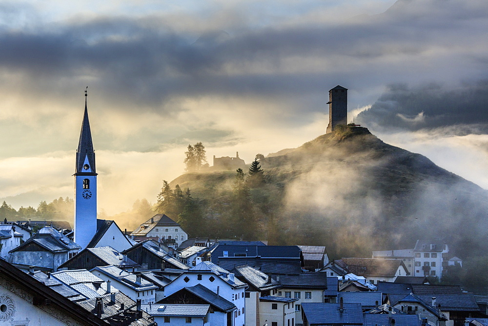 Misty sky on the alpine village of Ardez at sunrise, canton of Graubünden, district of Inn, lower Engadine, Switzerland, Europe - 1179-2385