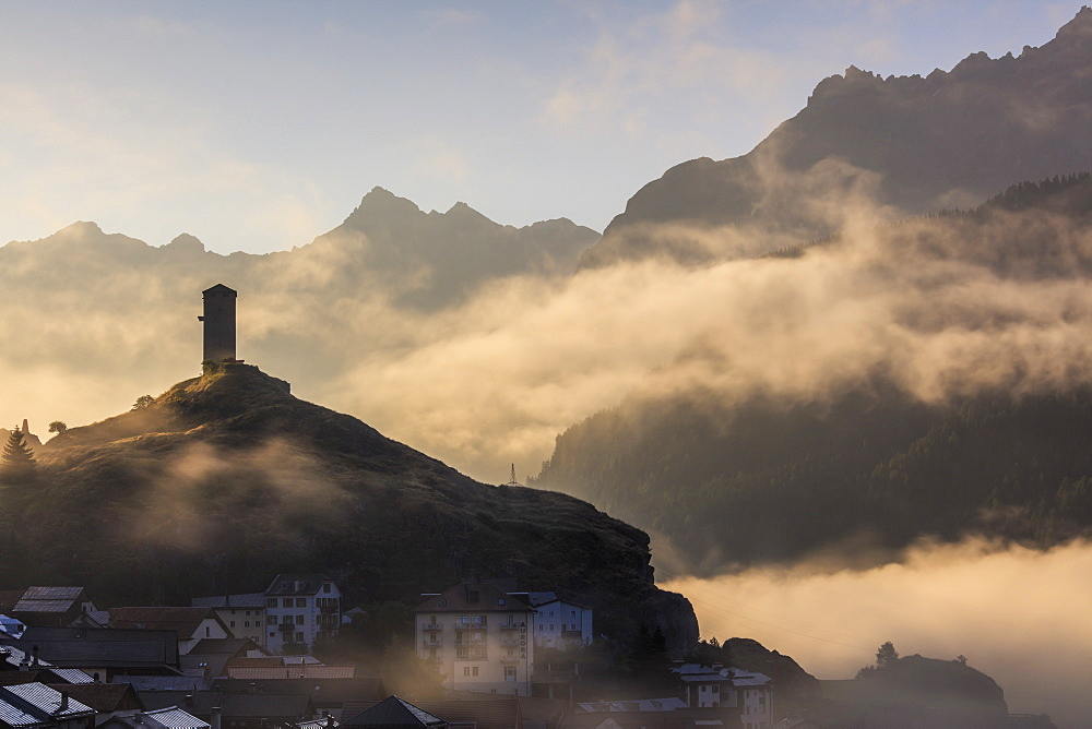 Tower of Steinsberg Castle shrouded by mist, Ardez, canton of Graubünden, district of Inn, lower Engadine, Switzerland, Europe