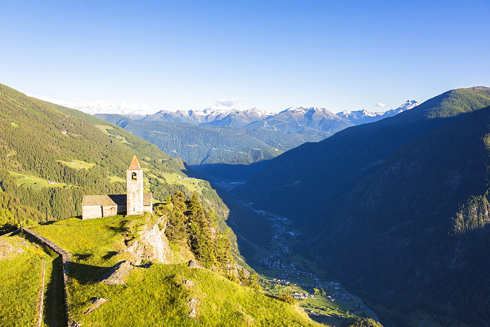 Ancient church perched on mountains, San Romerio Alp, Brusio, Canton of Graubunden, Poschiavo Valley, Switzerland, Europe