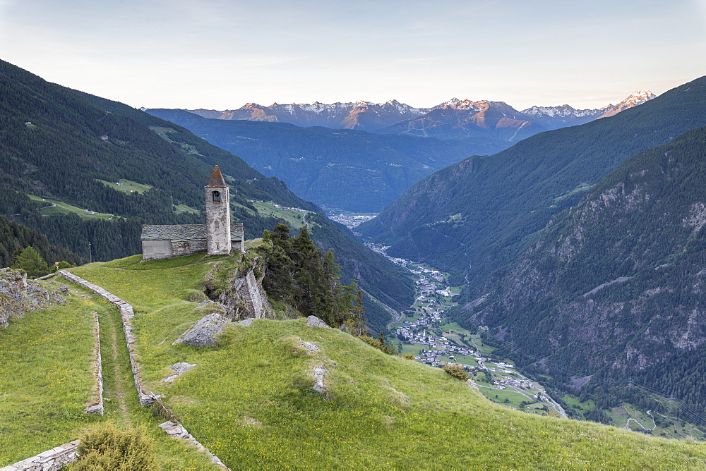 Ancient church at sunrise, San Romerio Alp, Brusio, Canton of Graubunden, Poschiavo Valley, Switzerland, Europe - 1179-2472
