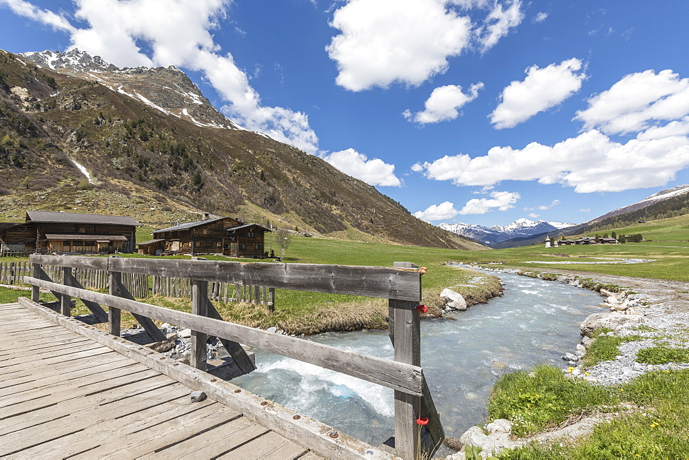 Wood bridge on the alpine river surrounding the village of Davos, Sertig Valley, canton of Graubunden, Switzerland, Europe