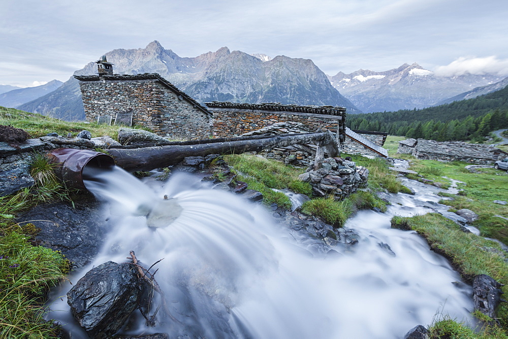 Flowing water of alpine creek, Entova Alp, Malenco Valley, Sondrio province, Valtellina, Lombardy, Italy