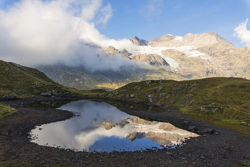 Piz Arlas, Cambrena, Caral reflected in water, Bernina Pass, Poschiavo Valley, canton of Graubünden, Engadine, Switzerland