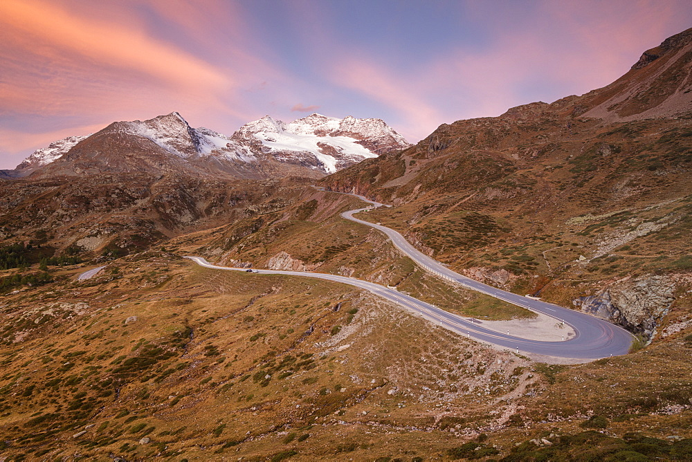 Road bends of Bernina Pass at dawn, Poschiavo Valley, Engadine, Canton of Graubunden, Switzerland, Europe