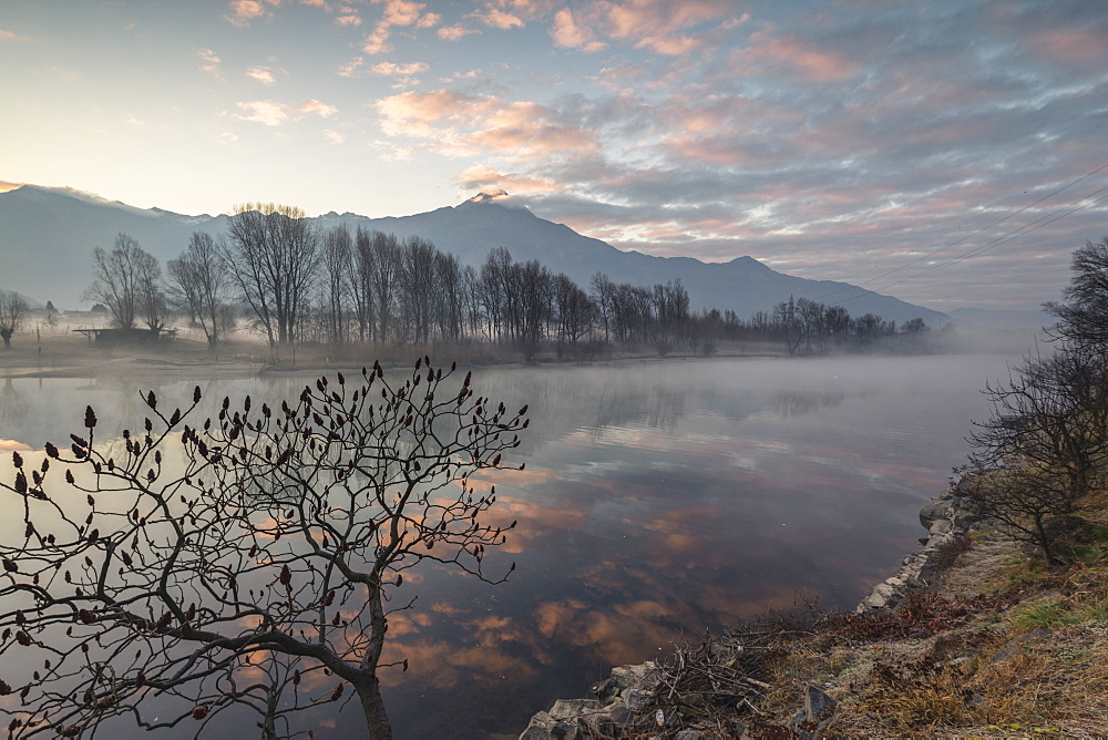 Clouds reflected in river Mera at dawn, Sorico, Como province, Lower Valtellina, Lombardy, Italy