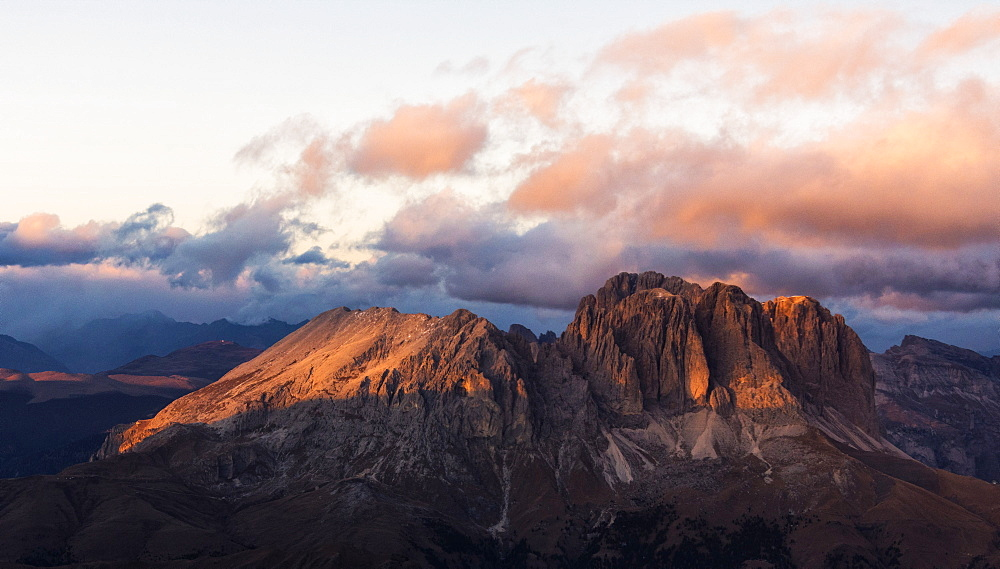 Aerial view of Sassolungo and Sassopiatto mountain range at sunset, Dolomites, South Tyrol, Italy