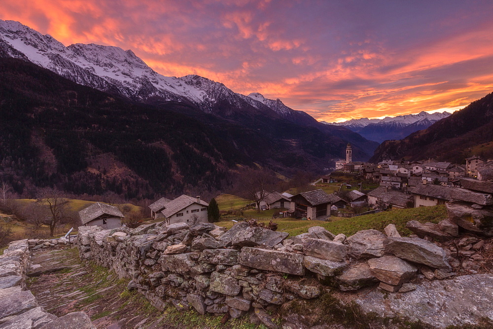 Fiery sky at sunset, Soglio, Bregaglia Valley, Maloja Region, Canton of Graubunden (Grisons), Switzerland, Europe
