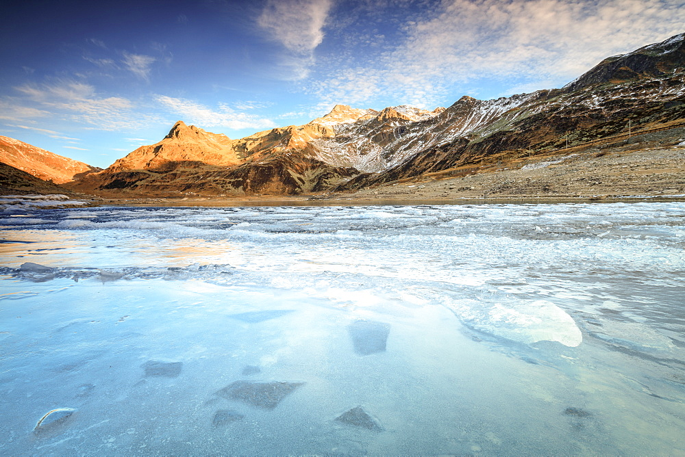 Frozen lake Montespluga at dawn, Chiavenna Valley, Sondrio province, Valtellina, Lombardy, Italy, Europe