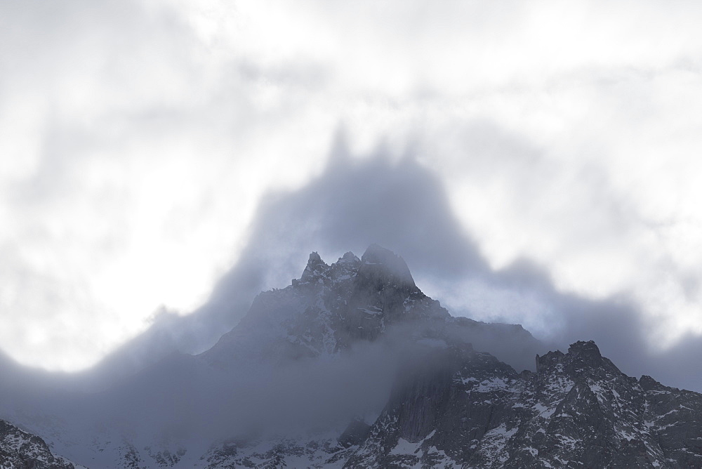 Shapes above peaks created by mist, Cime Del Largo, Bregaglia Valley, Canton of Graubunden (Grisons), Switzerland, Europe