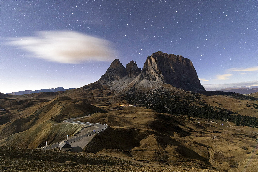 Starry sky on rocky peaks of Sassolungo, Sella Pass, Dolomites, South Tyrol, Bolzano province, Italy, europe