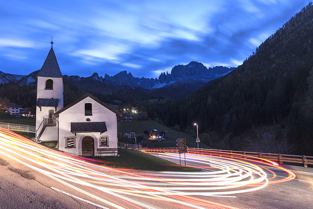 Lights of car trails around the Church of San Cipriano, Tires Valley, Dolomites, South Tyrol, Bolzano province, Italy, Europe
