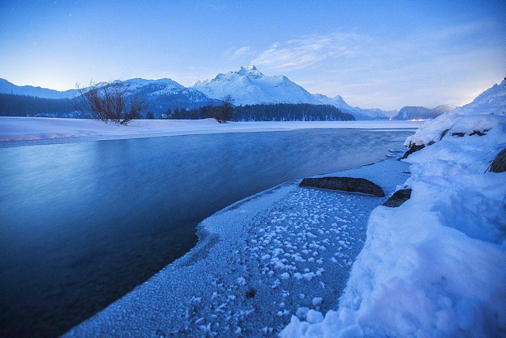Piz Da La Margna and icy Lake Sils, Maloja, Engadine, Canton of Graubunden, Switzerland, Europe