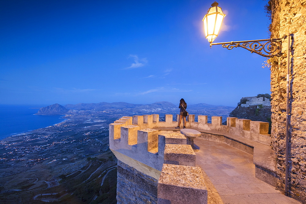 Woman on terrace looks towards Monte Cofano, Erice, province of Trapani, Sicily, Italy, Mediterranean, Europe