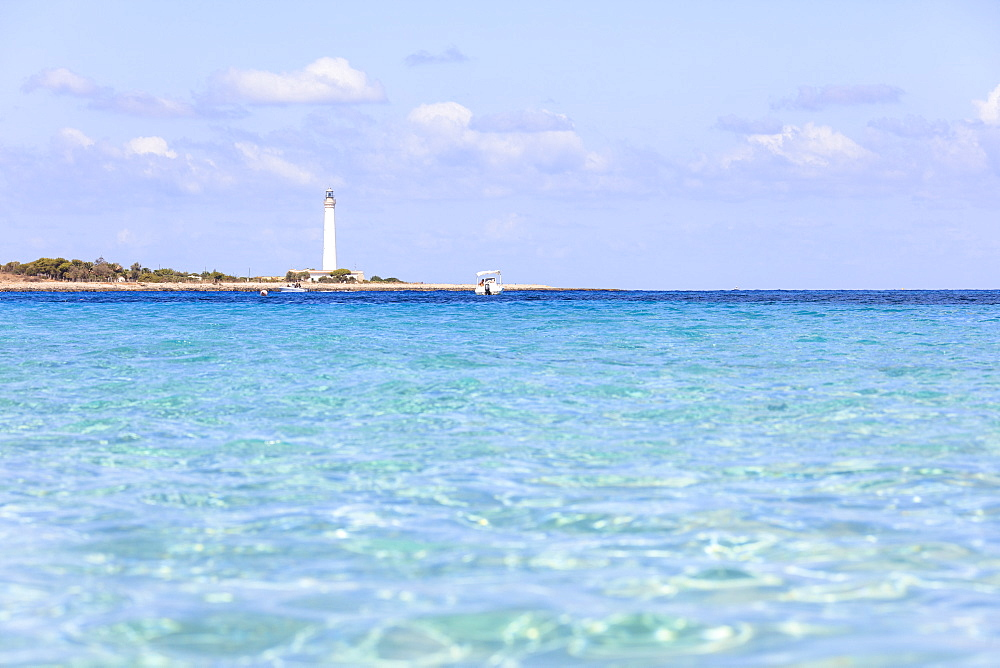 Turquoise sea with lighthouse in the background, San Vito Lo Capo, province of Trapani, Sicily, Italy