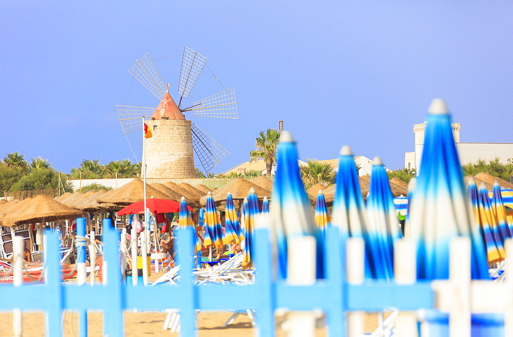 Beach umbrellas and windmill, Baia dei Mulini, Trapani, Sicily, Italy, Mediterranean, Europe