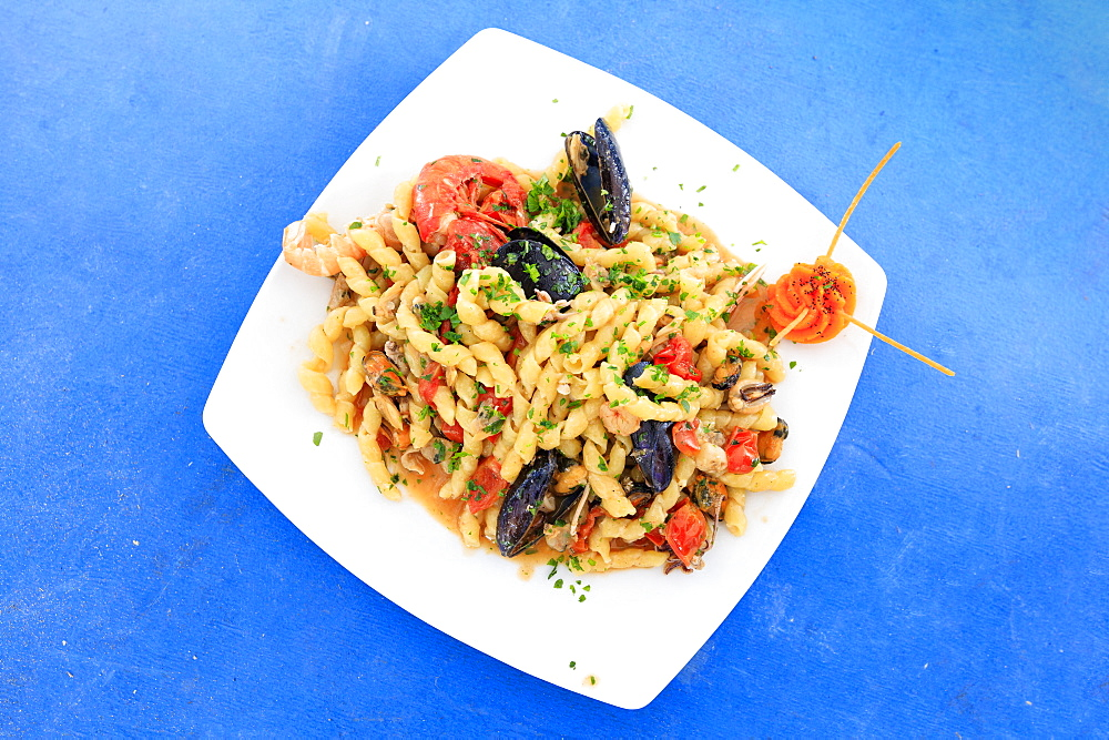 Pasta with seafood on platter, Sicily, Italy, Europe
