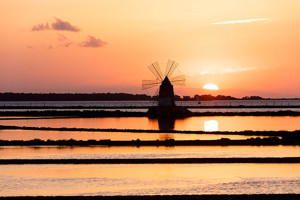 Windmill at sunset, Saline dello Stagnone, Marsala, province of Trapani, Sicily, Italy