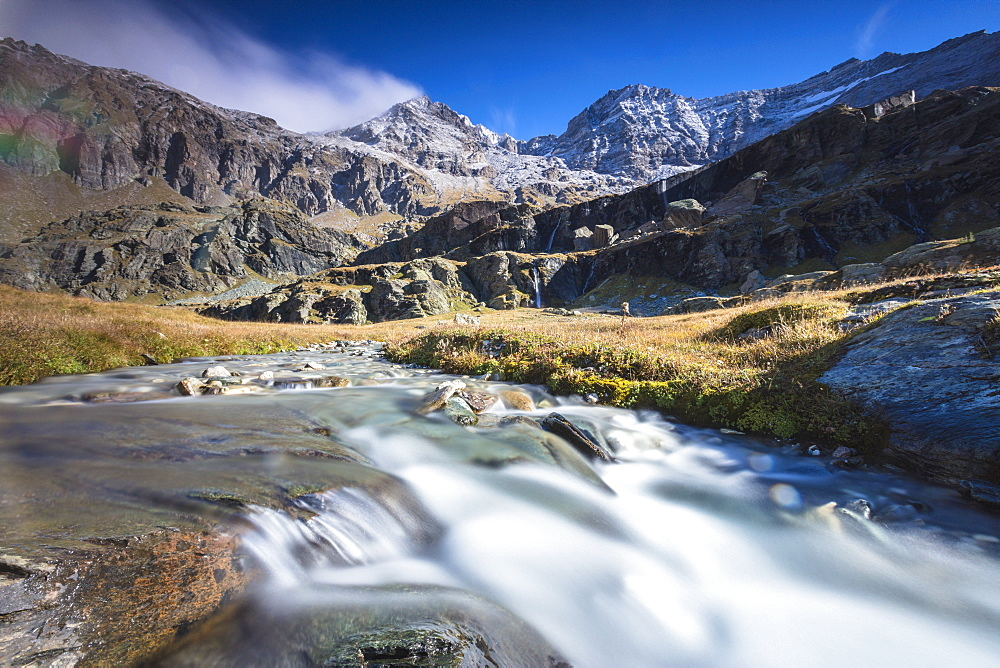Flowing water of alpine creek, Alpe Fora, Malenco Valley, province of Sondrio, Valtellina, Lombardy, Italy