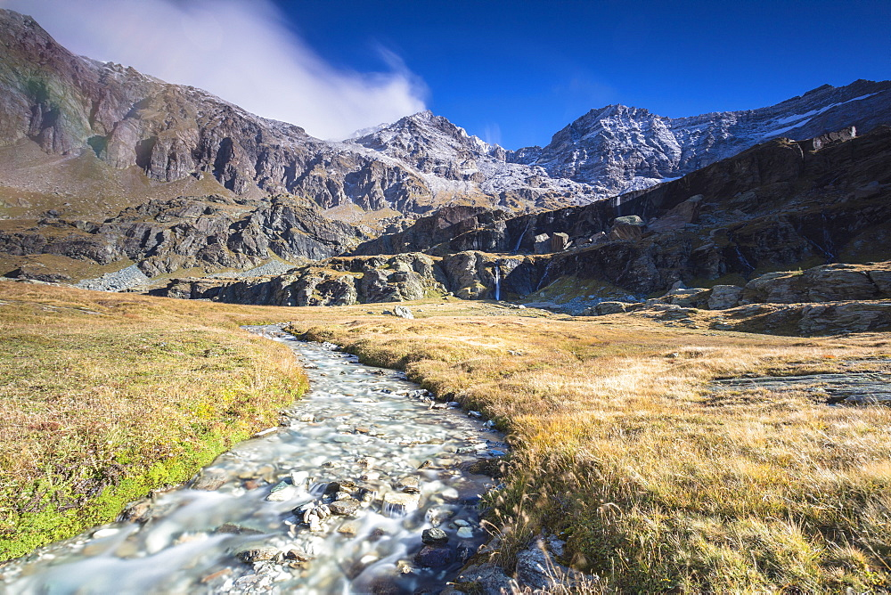 Creek flowing between meadows, Alpe Fora, Malenco Valley, province of Sondrio, Valtellina, Lombardy, Italy, EuropeCreek flowing between meadows, Alpe Fora, Malenco Valley, province of Sondrio, Valtellina, Lombardy, Italy, Europe