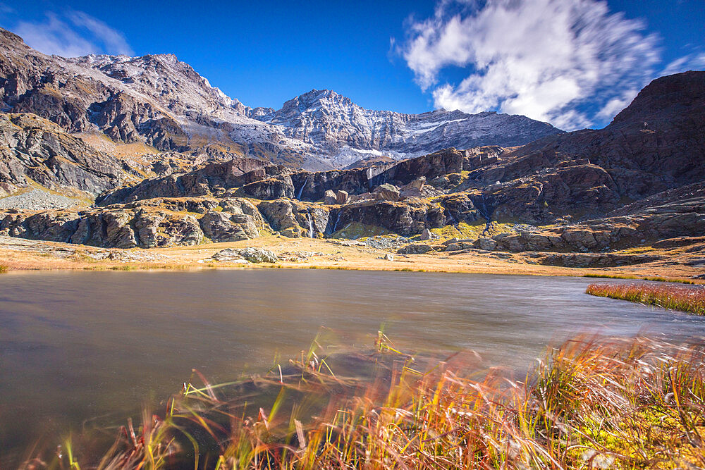 Alpine lake during autumn, Alpe Fora, Malenco Valley, province of Sondrio, Valtellina, Lombardy, Italy