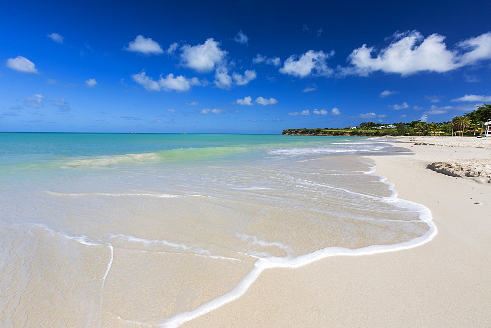 The waves of the Caribbean Sea crashing on the white sandy beach of Runaway Bay, north of the capital St. John's, Antigua, Leeward Islands, West Indies, Caribbean, Central America