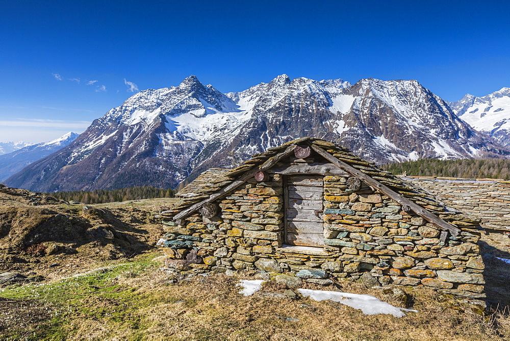 Stone hut, Entova Alp, Malenco Valley, province of Sondrio, Valtellina, Lombardy, Italy, Europe