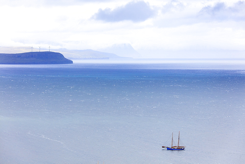 Isolated boat in the ocean during the historical regatta, Torshavn, Streymoy Island, Faroe Islands, Denmark, Europe