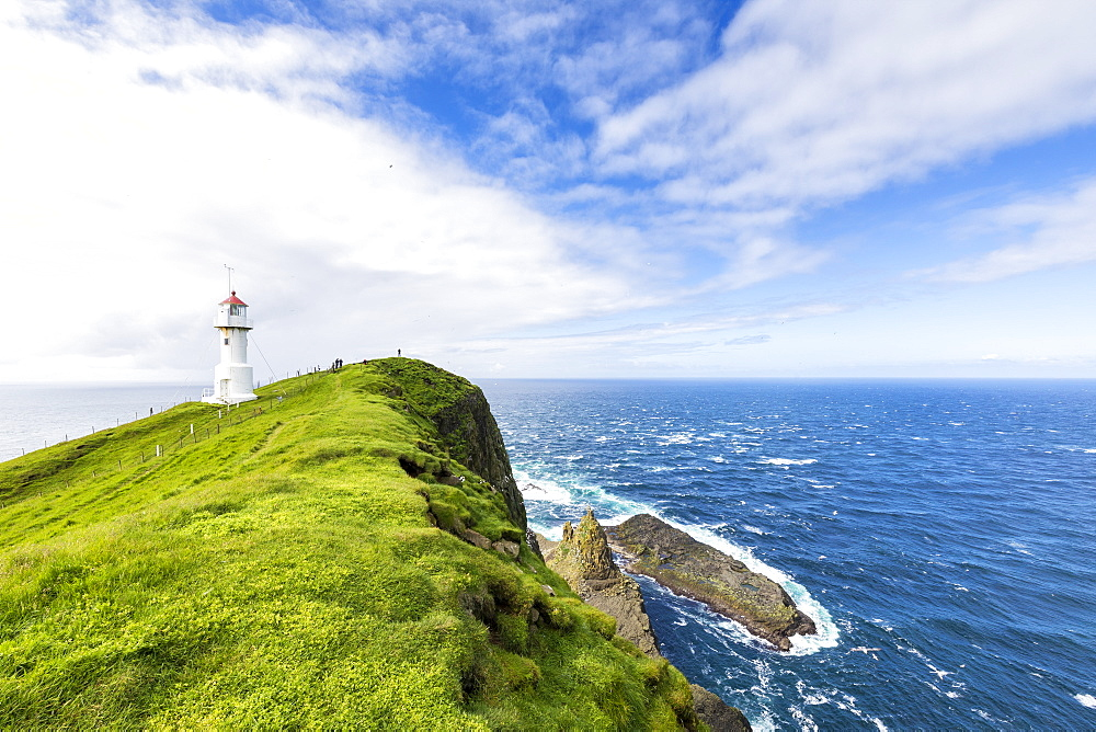 Lighthouse on islet known as Mykines Holmur, Mykines Island, Faroe Islands, Denmark, Europe