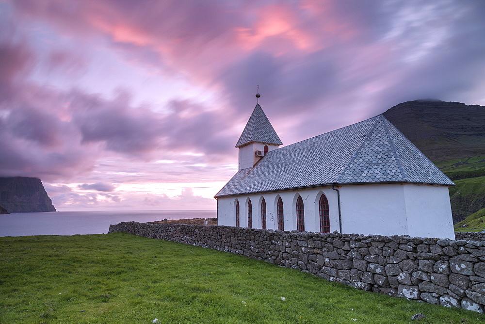 Sunrise on church of Vidareidi, Vidoy Island, Faroe Islands, Denmark, Europe