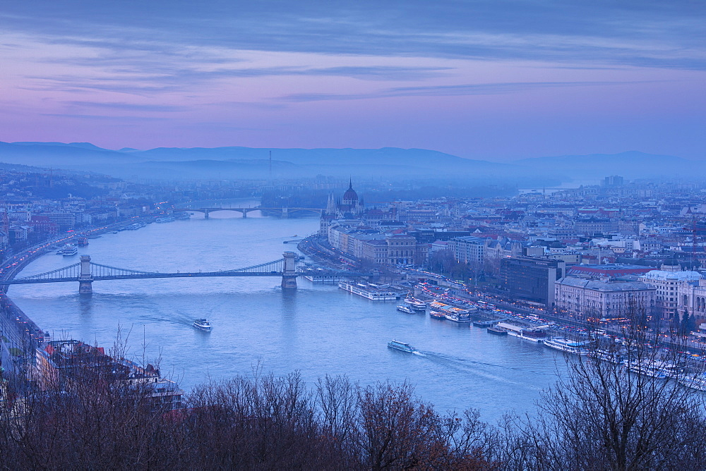 View over the city and River Danube at dusk from The Citadel on Gellert Hill, Budapest, Hungary, Europe