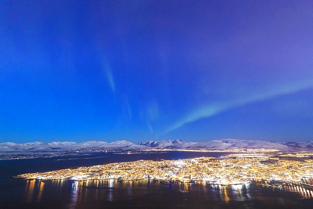 Northern Lights (Aurora borealis) on the city of Troms seen from Fjellheisen, Troms county, Norway, Scandinavia, Europe