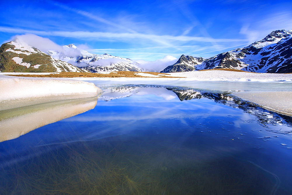 Lake Andossi during spring thaw, Chiavenna Valley, Spluga Valley, Sondrio province, Valtellina, Lombardy, Italy, Europe