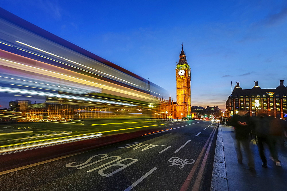 Doubledecker bus runs towards Big Ben (Elizabeth Tower), located north end of the Palace of Westminster, London, England, United Kingdom, Europe