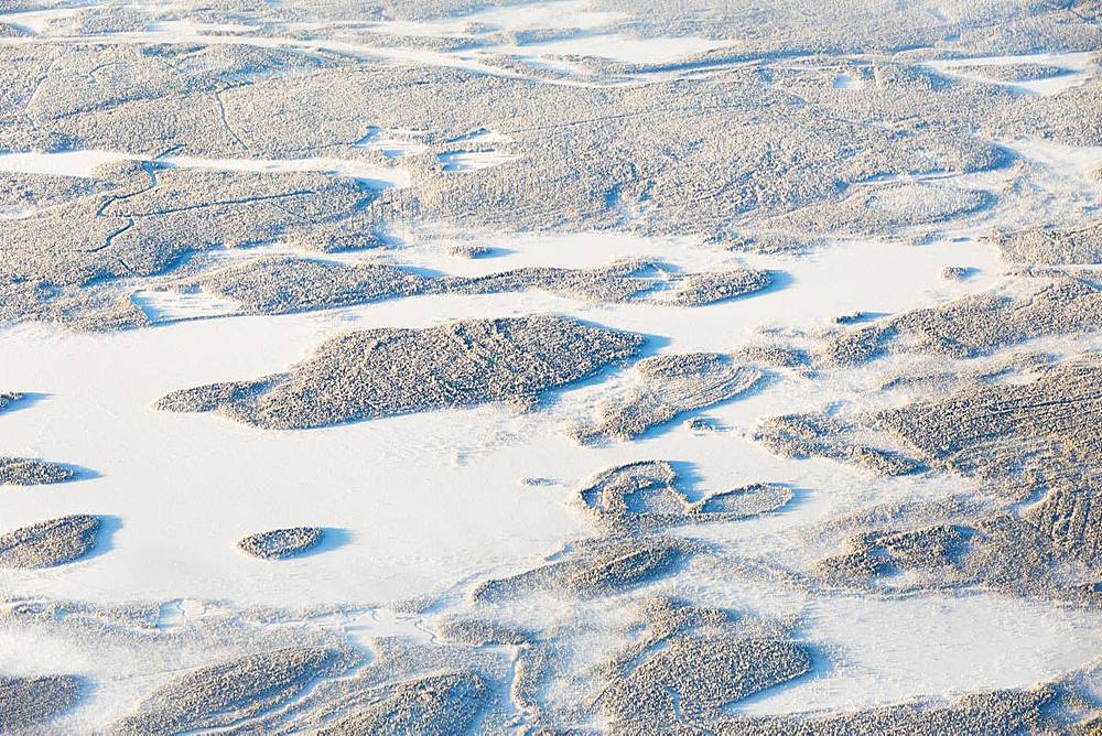 Aerial view of forest and hills in the frozen landscape, Levi, Kittila, Lapland, Finland