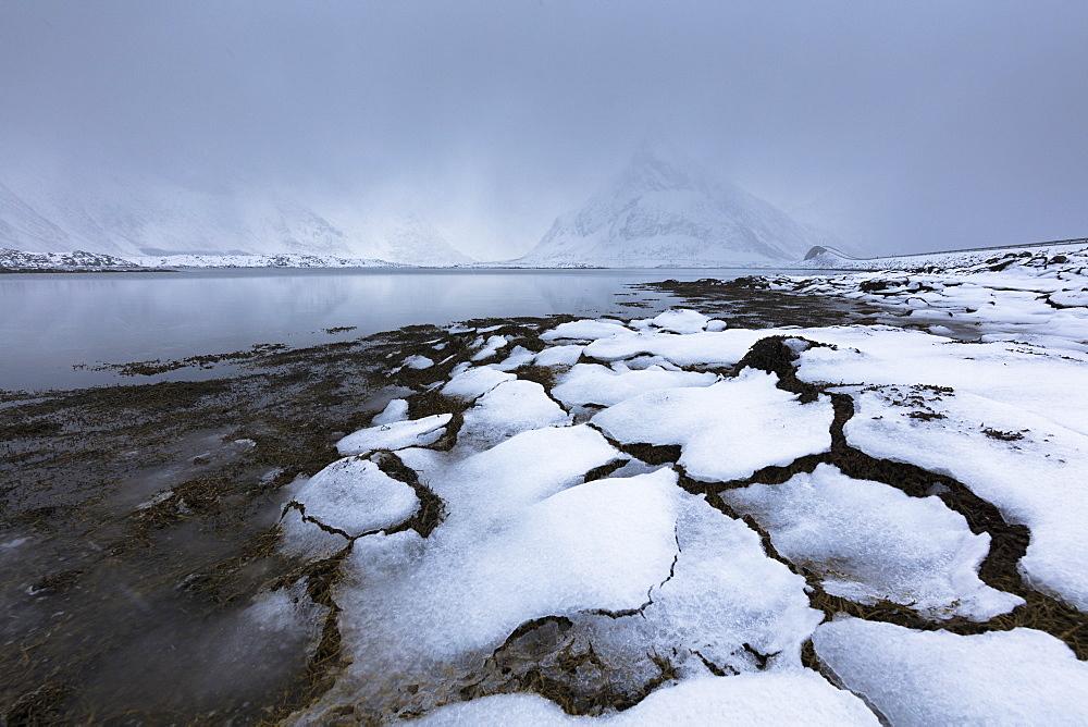 Mist on the snowy peak of Volanstinden, Fredvang, Lofoten Islands, Nordland, Norway, Europe - 1179-3346