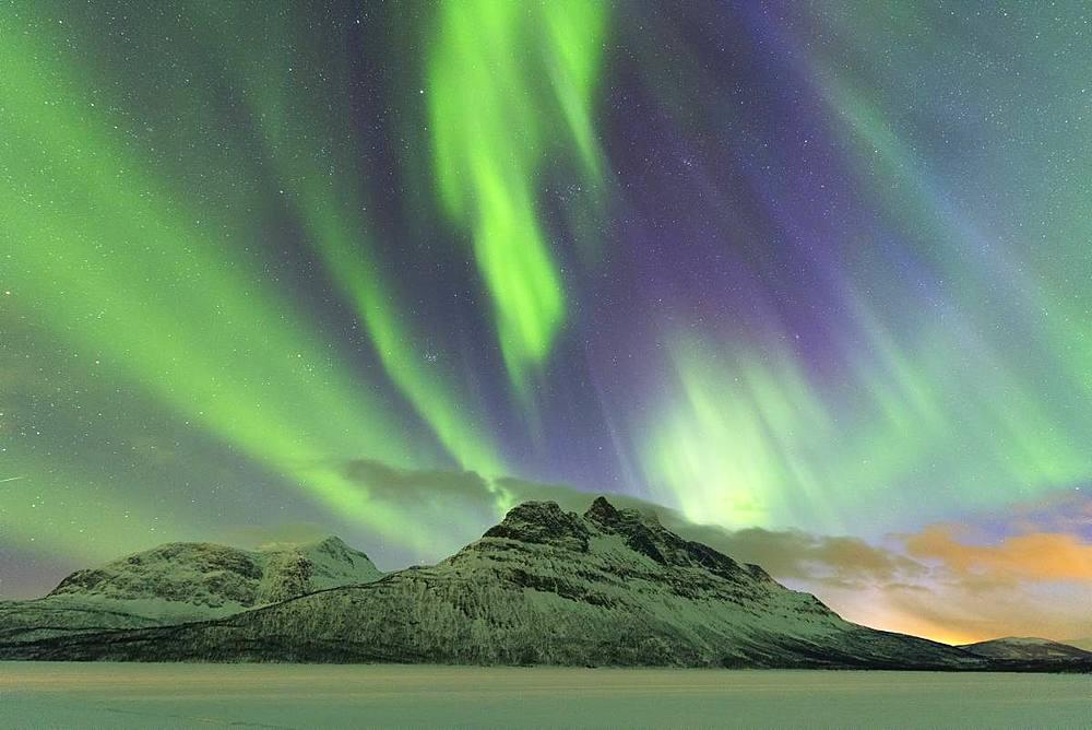 Northern Lights (Aurora borealis) on frozen lake Skoddebergvatnet, Grovfjord, Troms county, Lofoten Islands, Nordland, Norway, Europe - 1179-3364
