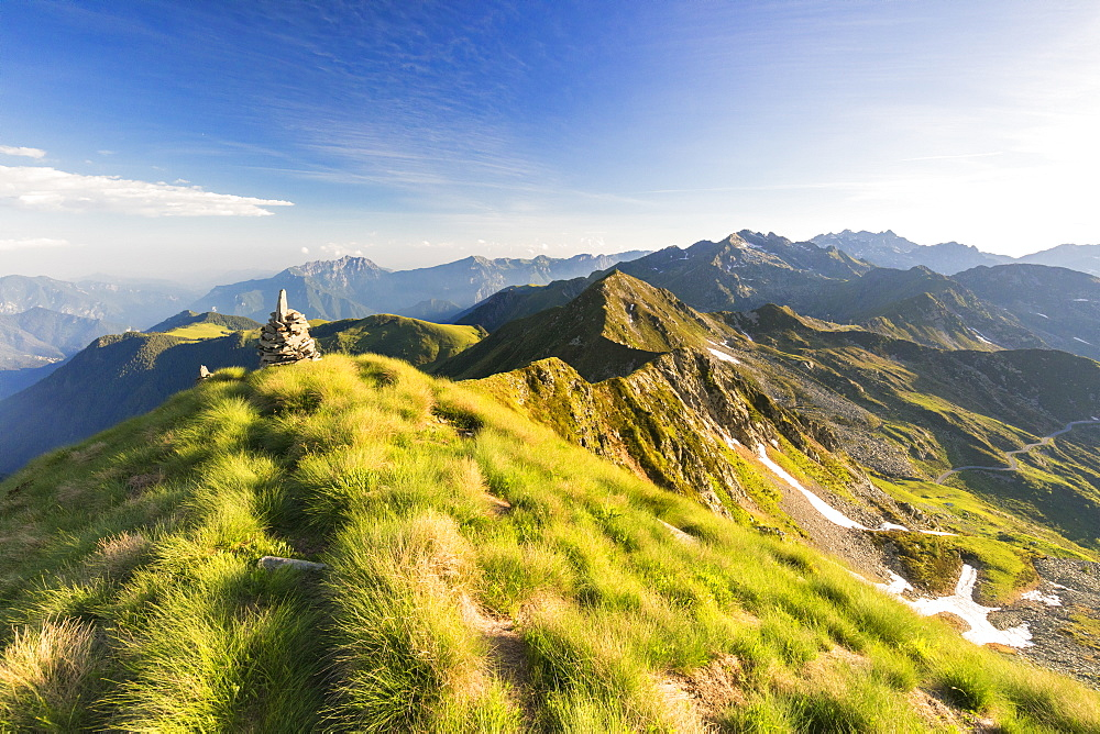 Grass on the steep ridge on the ascent towards Monte Azzarini, San Marco Pass, Albaredo Valley, Orobie Alps, Lombardy, Italy, Europe