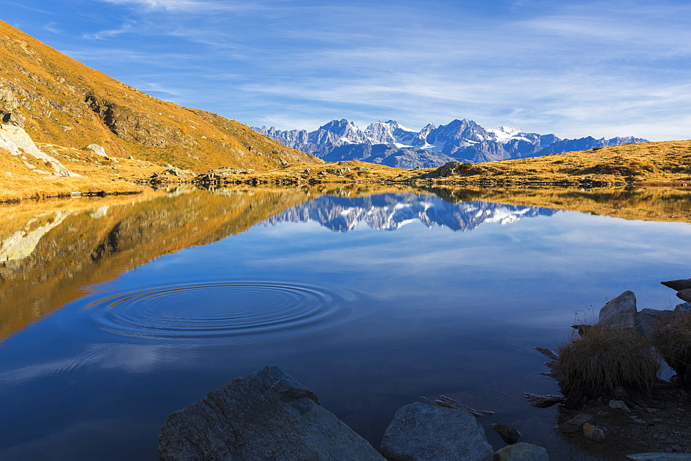 Peaks of Bernina Group reflected in the blue Lago Arcoglio during autumn, Valmalenco, Valtellina, Lombardy, Italy, Europe