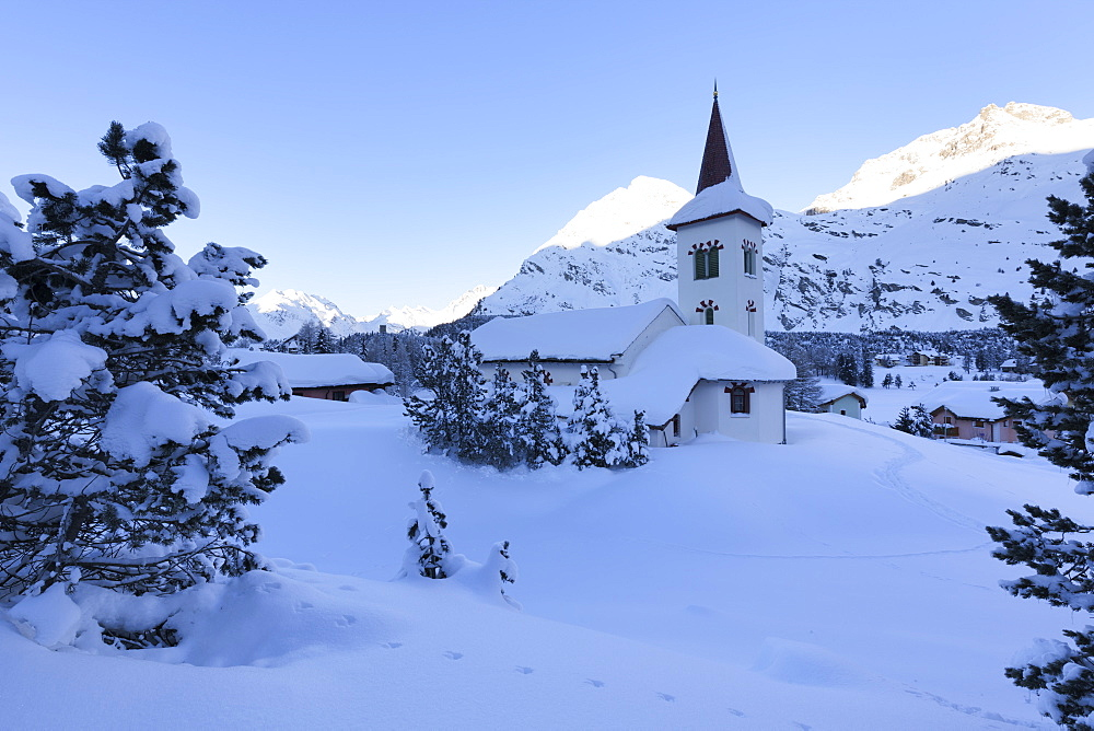 Chiesa Bianca surrounded by snow, Maloja, Bregaglia Valley, Engadine, Canton of Graubunden, Switzerland, Europe
