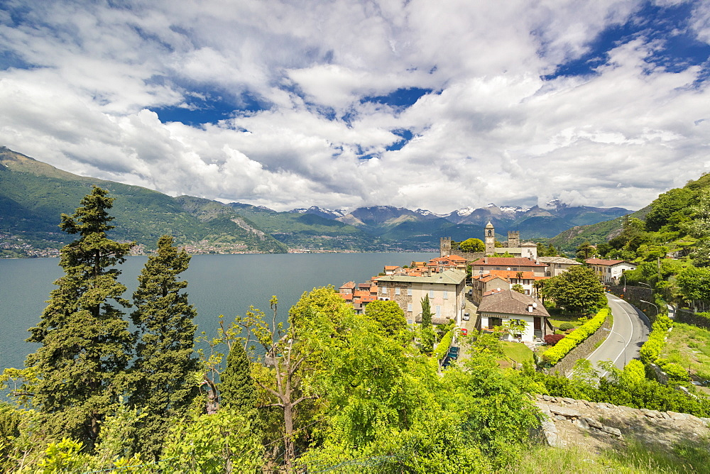 Clouds over the medieval village of Corenno Plinio and Lake Como, Dervio, Lecco province, Lombardy, Italian Lakes, Italy, Europe
