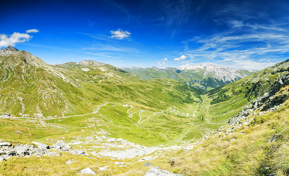 Panoramic of winding road and green valley towards the village of Splugen, Spluga Pass, canton of Graubunden, Switzerland, Europe