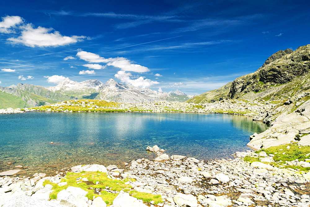 Turquoise crystalline water of lake Bergsee, Spluga Pass, canton of Graubunden, Switzerland, Europe