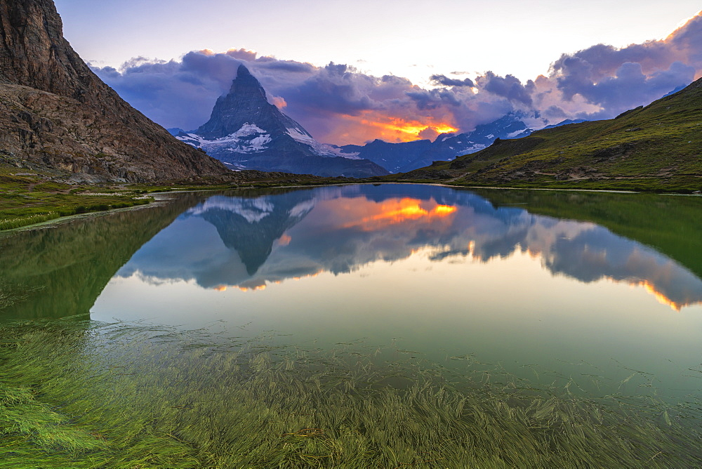 Sunset over the Matterhorn reflected in lake Riffelsee, Zermatt, canton of Valais, Swiss Alps, Switzerland, Europe