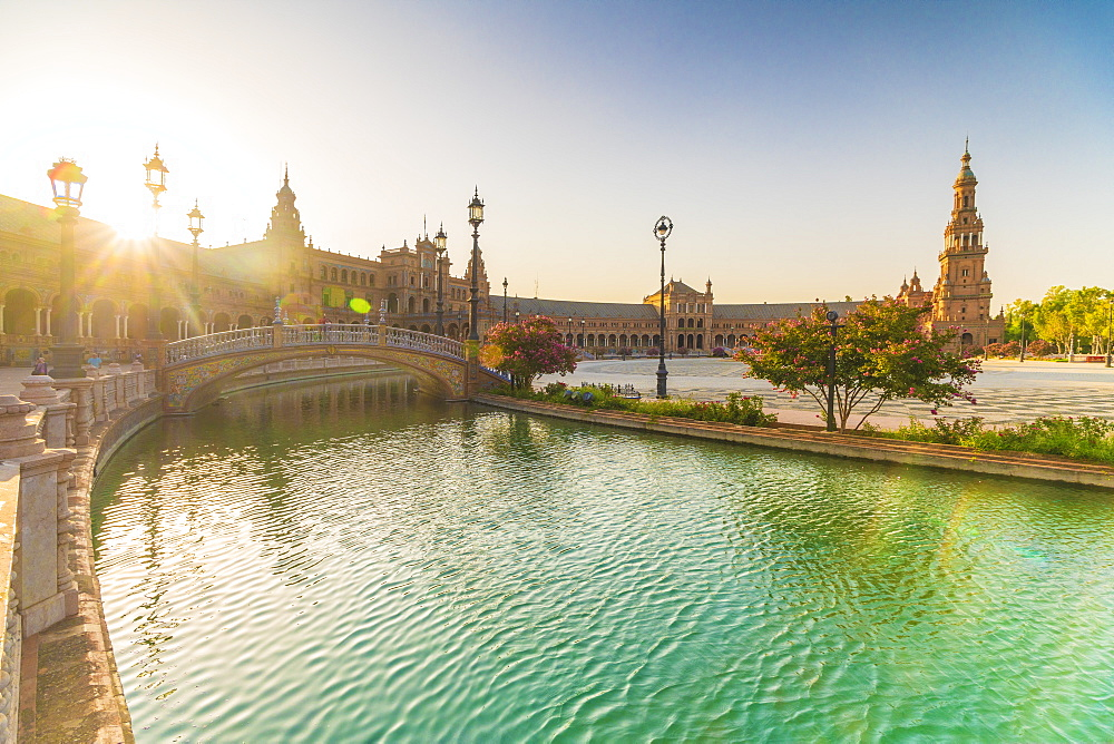 Sunrise over the decorated buildings and bridges along the canal, Plaza de Espana, Seville, Andalusia, Spain, Europe