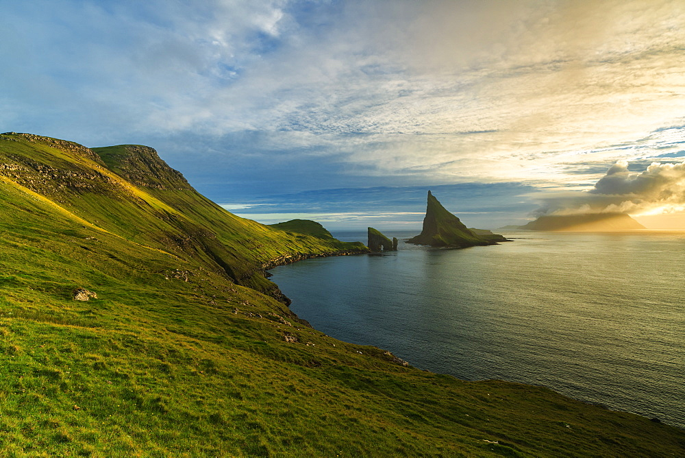 Drangarnir rock seen from the green hills along the hiking trail, Vagar island, Faroe Islands, Denmark, Europe