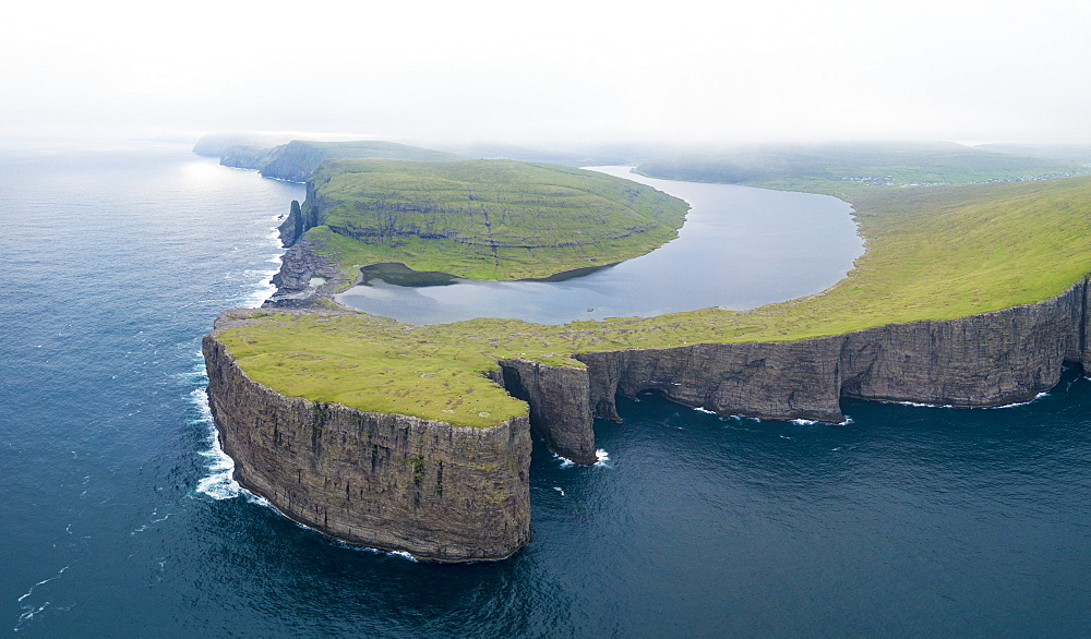Lake Leitisvatn (Sorvagsvatn) on cliffs above the ocean, Vagar island, Faroe Islands, Denmark, Europe